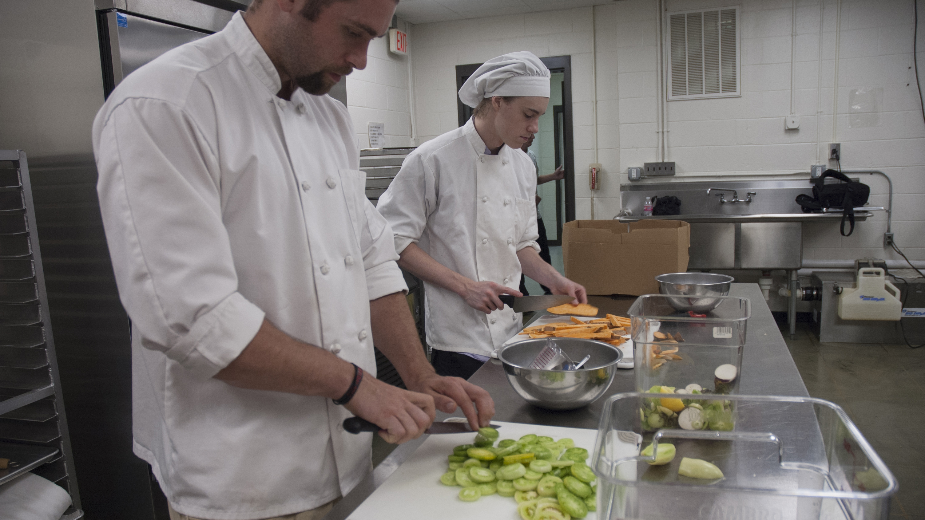 Students cutting produce.