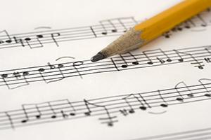 Close up photograph of handwriten music, shallow depth of field.