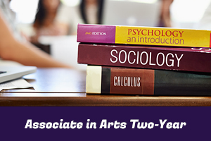 Associate in Arts Two-Year: photo of psychology, sociology, and calculus textbooks stacked on a desk
