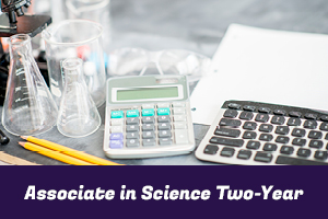 Associate in Science Two-Year: photo of a microscope, beakers, calculator and keyboard sitting on a desk